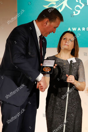 British champion rower Matthew Pinsent presents the Recognising Achievement Award to Kelly Ganfield at the annual Endeavour Fund Awards at Draper's Hall.