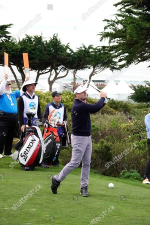 Stock Picture of Chris O Donnell tees off on the 7th in his first round at  the AT&T Pro-Am at Pebble Beach Golf Links