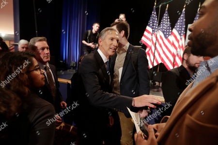 Former Starbucks CEO Howard Schultz greets students after speaking at Purdue University in West Lafayette, Ind