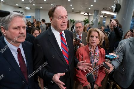 Stock Image of Richard Shelby, Shelley Moore Capito, John Hoeven. Sen. Richard Shelby, R-Ala., the top Republican on the bipartisan group bargainers working to craft a border security compromise in hope of avoiding another government shutdown, is joined by Sen. John Hoeven, R-N.D., left, and Sen. Shelley Moore Capito, R-W.Va., right, as they speak with reporters in Washington. Congressional bargainers seem close to clinching a border security agreement that would avert a fresh government shutdown, with leaders of both parties voicing optimism and the top GOP negotiator saying he believes President Donald Trump would back the emerging accord