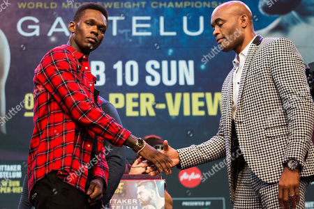 Israel Adesanya (left) and Anderson Silva (right) shake hands during the Ultimate Fighting Championship 234 pre fight press conference
