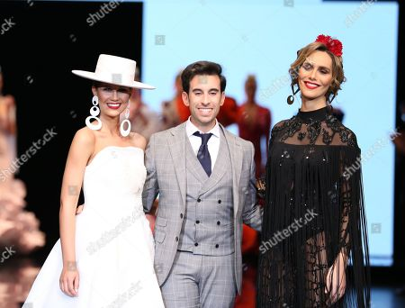 Designer Luis Fernandez and models on the catwalk
