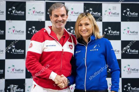 Stock Picture of Switzerland's team captain Heinz Guenthardt (L) and Italy's captain Tathiana Garbin, pose for photgraphers during the draw ceremony ceremony of the Fed Cup world group II, first round tie between Switzerland and Italy in the Swiss Tennis Arena in Biel, Switzerland, 08 February 2019.