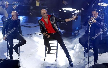 Stock Picture of Italian vocalist Pau (C) of the band Negrita and Italian singer Enrico Ruggeri (L) perform with Italian musician Roy Paci (R) on stage at the Ariston theatre during the 69th Sanremo Italian Song Festival, Sanremo, Italy, 08 February 2019. The festival runs from 05 to 09 February.