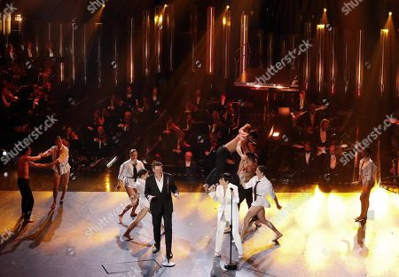 Italian singer Arisa (C-R) and British singer Tony Hadley (C-L) with Italian dance theater company Kataklo dancers perform on stage at the Ariston theatre during the 69th Sanremo Italian Song Festival, Sanremo, Italy, 08 February 2019. The festival runs from 05 to 09 February.