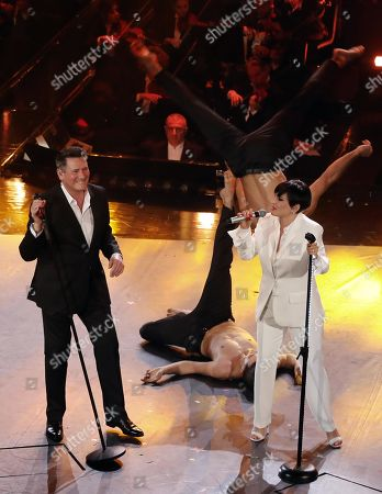 Italian singer Arisa (R) and British singer Tony Hadley (L) with Italian dance theater company Kataklo dancers perform on stage at the Ariston theatre during the 69th Sanremo Italian Song Festival, Sanremo, Italy, 08 February 2019. The festival runs from 05 to 09 February.