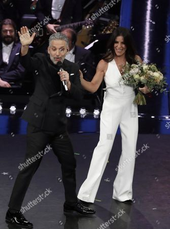 Paola Turci (R) with Italian actor Beppe Fiorello (L) perform on stage at the Ariston theatre during the 69th Sanremo Italian Song Festival, Sanremo, Italy, 08 February 2019. The festival runs from 05 to 09 February.