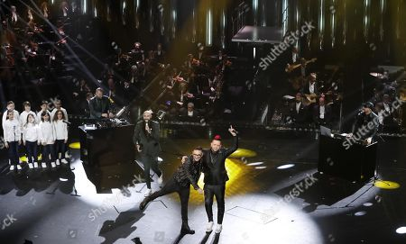 Stock Photo of Italian band Boomdabash with Italian singer Rocco Hunt and the Musici Cantori di Milano perform on stage at the Ariston theatre during the 69th Sanremo Italian Song Festival, Sanremo, Italy, 08 February 2019. The festival runs from 05 to 09 February.