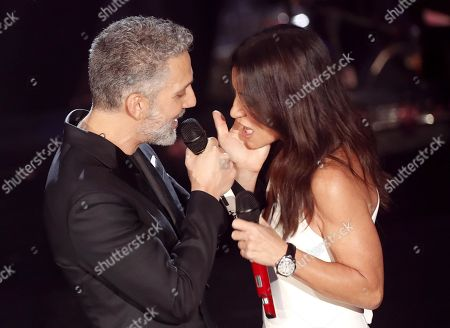 Paola Turci (R) with Italian actor Giuseppe Fiorello (L) perform on stage at the Ariston theatre during the 69th Sanremo Italian Song Festival, Sanremo, Italy, 08 February 2019. The festival runs from 05 to 09 February.