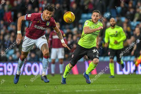 Tyrone Mings (40) of Aston Villa heads the ball back to Lovre Kalinic (28) of Aston Villa
