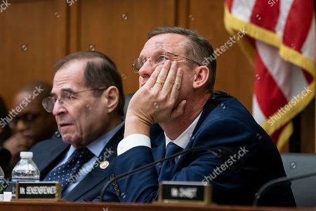 Jerrold Nadler, Doug Collins. Judiciary Committee Chairman Jerrold Nadler, D-N.Y., left, and Rep. Doug Collins, R-Georgia, right, the top Republican, listen during testimony by Acting Attorney General Matthew Whitaker on Capitol Hill, in Washington. Democrats are pressing him on his interactions with President Donald Trump and his oversight of the special counsel's Russia investigation