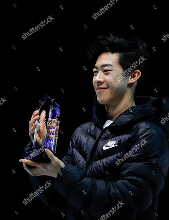 Nathan Chen holds his Readers' Choice Skater of the Year Award, the Michelle Kwan Trophy, based on the accomplishments of the past season, after the U.S. Figure Skating Championships, in Detroit