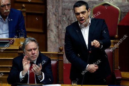Alexis Tsipras, George Katrougalos. Greece's Prime Minister Alexis Tsipras, right, speaks as Greek Alternate Minister of Foreign Affairs George Katrougalos, applauds during a parliament session in Athens, . Greek lawmakers are set Friday to approve Macedonia's NATO accession, ending a process to normalize relations between the two neighbors and anchor the country ? renamed North Macedonia ? firmly within the western sphere of influence