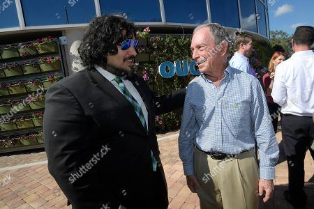 Former New York City Mayor Michael Bloomberg, right, talks with Clayton Ferrara, executive director of Ideas for Us, while touring an Orlando Utilities Commission facility, in Orlando, Fla. Bloomberg says he's planning to decide by the end of the month whether he'll seek the presidency. The billionaire businessman, one of the richest men in the world, has been openly contemplating a Democratic White House bid