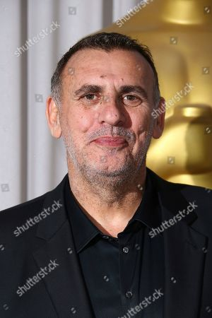 Graham King poses for photographers upon arrival for the Academy Oscar Nominee Reception in London