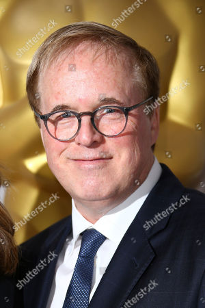 Brad Bird poses for photographers upon arrival for the Academy Oscar Nominee Reception in London