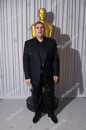 Stock Photo of Graham King poses for photographers upon arrival for the Academy Oscar Nominee Reception in London