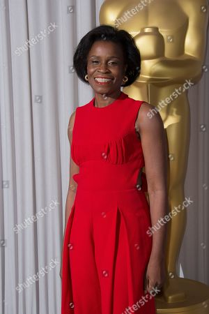 Stock Image of Misan Sagay poses for photographers upon arrival for the Academy Oscar Nominee Reception in London