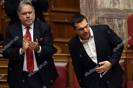 Alternate Greek Foreign Minister George Katrougalos (L) applauses Greek Prime Minister Alexis Tsipras after his speech during a debate, prior to a roll-call voting, in the Greek Parliament on the draft bill 'Ratification of the Protocol of the North Atlantic Treaty for the Accession of North Macedonia' whereby Greece will approve the accession of its northern neighbour to NATO under its new name, as provided by the Prespes Agreement signed by Athens and Skopje, in Athens, Greece, 08 February 2019.