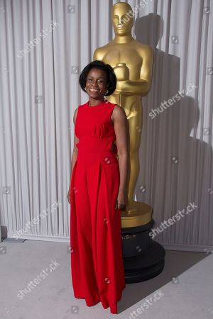 Stock Photo of Misan Sagay poses for photographers upon arrival for the Academy Oscar Nominee Reception in London