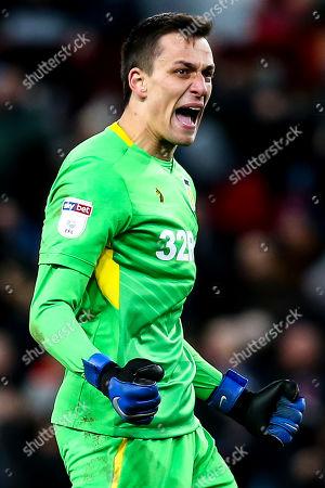 Lovre Kalinic of Aston Villa celebrates Andre Green of Aston Villa scoring a goal to make it 3-3