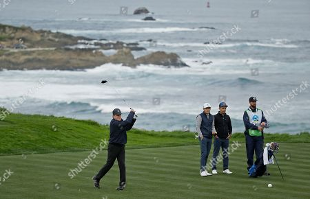Thomas Keller, Scott Langley, Dan Rose. Thomas Keller hits from the fourth tee of the Spyglass Hill Golf Course during the second round of the AT&T Pebble Beach National Pro-Am golf tournament, in Pebble Beach, Calif. Looking on is Scott Langley, second from left, and Dan Rose, second from right