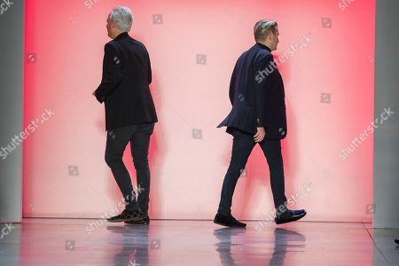Mark Badgley, James Mischka. Designers Mark Badgley, left, and James Mischka walk off stage after their Badgley Mischka collection was modeled during New York Fashion Week