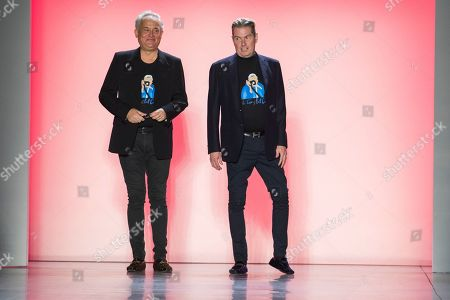 Mark Badgley, James Mischka. Designers Mark Badgley, left, and James Mischka acknowledge audience applause after their Badgley Mischka collection was modeled during New York Fashion Week