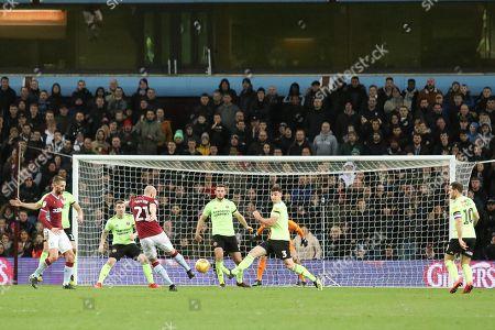 Aston Villa's Alan Hutton has a shot on goal