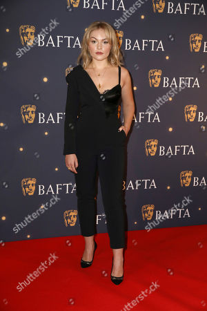 Ciara Charteris poses for photographers on arrival at a BAFTA Fundraising Gala, in London