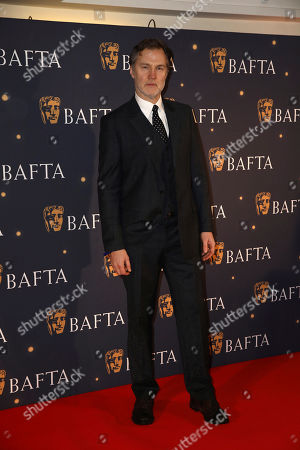 David Morrissey poses for photographers on arrival at a BAFTA Fundraising Gala, in London