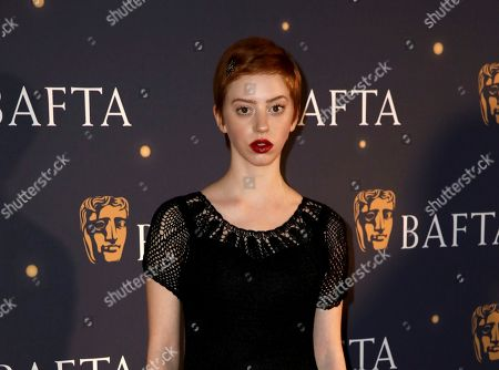 Lily Newmark poses for photographers on arrival at a BAFTA Fundraising Gala, in London