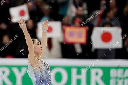 Bronze medal winner, Mai Mihara, of Japan, reacts during the women's free skate competition at the Four Continents Figure Skating Championships, in Anaheim, Calif