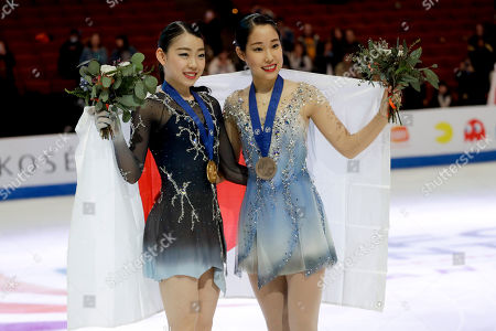 Gold medal winner, Rika Kihira, left, of Japan, and bronze medal winner, Mai Mihara, of Japan pose at the Four Continents Figure Skating Championships, in Anaheim, Calif