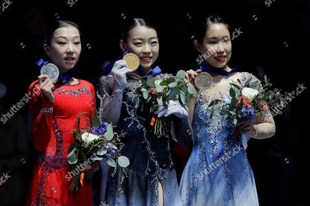 From left, silver medal winner Elizabet Tursynbaeva, of Kazakhstan, gold medal winner, Rika Kihira, of Japan, and bronze medal winner, Mai Mihara, of Japan pose at the Four Continents Figure Skating Championships, in Anaheim, Calif