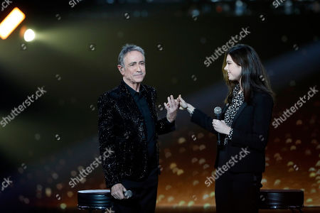 French singer Alain Chamfort, left, and his daughter Tess perform during the 34th Victoires de la Musique, the annual French music awards ceremony, in Paris