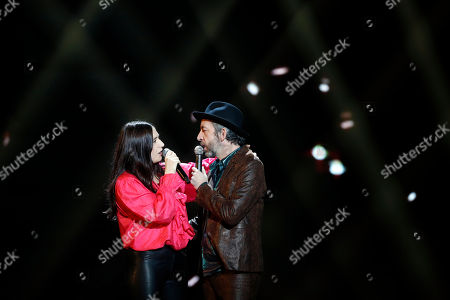French singers Izia Higelin, left, and Arthur H. perform on stage during the 34th Victoires de la Musique, the annual French music awards ceremony, in Paris