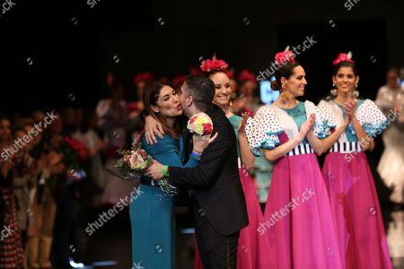 Designer Javier Garcia and Raquel Revuelta on the catwalk