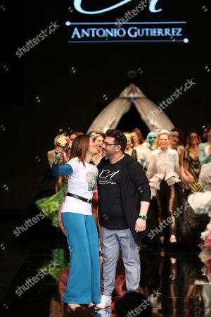 Antonio Gutierrez and Raquel Revuelta kiss on the catwalk