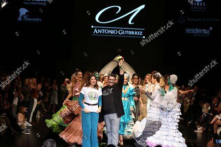Antonio Gutierrez,his models and Raquel Revuelta kiss on the catwalk