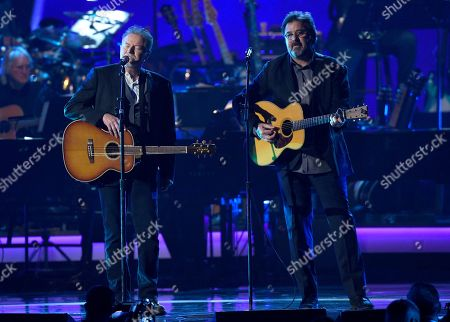 """Stock Image of Don Henley, Vince Gil. Don Henley, left, and Vince Gill perform """"Eagle When She Flies"""" at MusiCares Person of the Year honoring Dolly Parton, at the Los Angeles Convention Center"""