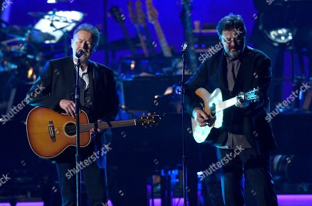 """Don Henley, Vince Gil. Don Henley, left, and Vince Gill perform """"Eagle When She Flies"""" at MusiCares Person of the Year honoring Dolly Parton, at the Los Angeles Convention Center"""
