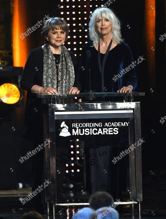 Emmylou Harris, Linda Ronstadt. Linda Ronstadt, left, and Emmylou Harris present the MusiCares Person of the Year award, at the Los Angeles Convention Center