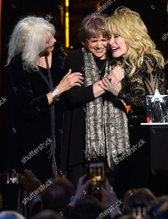 Emmylou Harris, Linda Ronstadt, Dolly Parton. Emmylou Harris, from left, and Linda Ronstadt present Dolly Parton with the MusiCares Person of the Year award, at the Los Angeles Convention Center