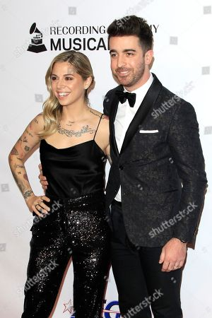 Christina Perri (L) and Paul Costabile arrive for the 2019 MusiCares Person of the Year Tribute in Los Angeles, California, USA 08 February 2019. MusiCares Person of the Year Tibute honored US musician Dolly Parton for her extraordinary creative accomplishments and significant charitable work.