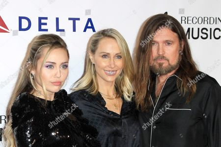 Miley Cyrus, Tish Cyrus and Billy Cyrus arrive for the 2019 MusiCares Person of the Year Tribute in Los Angeles, California, USA 08 February 2019. MusiCares Person of the Year Tibute honored US musician Dolly Parton for her extraordinary creative accomplishments and significant charitable work.
