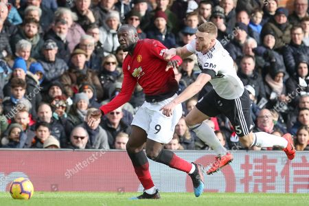 Manchester United Forward Romelu Lukaku battles its Fulham defender Calum Chambers (5) during the Premier League match between Fulham and Manchester United at Craven Cottage, London