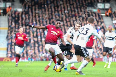 Manchester United Midfielder Paul Pogba battles with Fulham defender Calum Chambers (5) and Fulham defender Joe Bryan (23) during the Premier League match between Fulham and Manchester United at Craven Cottage, London
