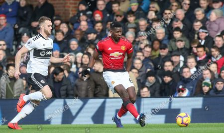 Manchester United Midfielder Paul Pogba battles with Fulham defender Calum Chambers (5) during the Premier League match between Fulham and Manchester United at Craven Cottage, London