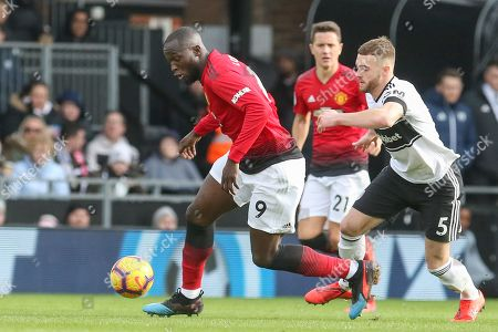 Manchester United Forward Romelu Lukaku battles with Fulham defender Calum Chambers (5) during the Premier League match between Fulham and Manchester United at Craven Cottage, London